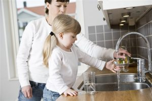 mother and daughter on the kitchen sink - home inspection seattle