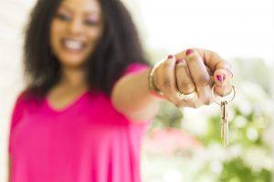woman-handing-over-keys
